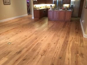 Wire brushed white oak character grade wood flooring installed