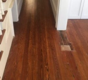 Water damaged old heart pine flooring needs repair and refinishing