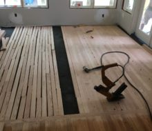 Installing Red Oak clear grade flooring in the addition