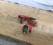 Nail gun for plywood to concrete slab