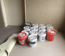 Buckets of removed condo tile