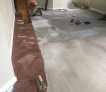 Birch wood floor installation over leveled subfloor