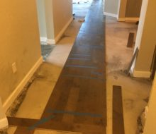 Wood floor installation w/ straps for wide birch plank flooring