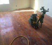 Lager-Hummel Belt Sanding Machine on solid red oak flooring - before