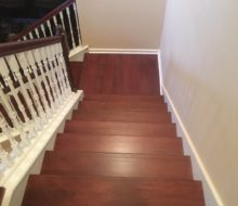 New Brazilian Cherry stair treads - custom stained and installed with new wood flooring on landing