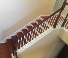New Brazilian Cherry stair treads - custom stained and installed with new wood flooring on landing and upstairs hall