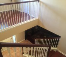 New Brazilian Cherry stair treads - custom stained and installed with new wood flooring upstairs