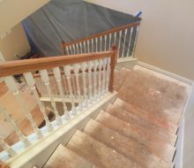 Staircase and landing with carpet removed.