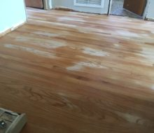 "water ""popped"" solid red oak flooring"