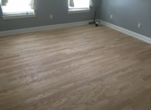 Sanded and hand scraped peeled Red Oak floor