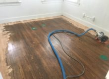 Sanding old wooden floor