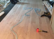 Installing drilled red oak planks with nickels for expansion