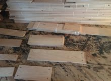 Some varied width red oak plank flooring drilled for walnut pegs