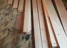 Staging drilled red oak planks