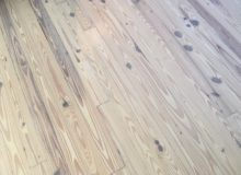 Whitened, knotty heart pine flooring