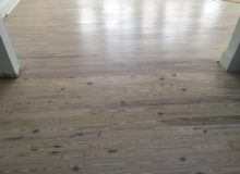 Whitened, knotty heart pine flooring adjacent whitened mixed red and white oak flooring