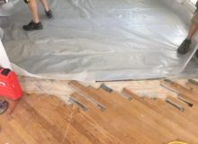 Installing vapor membrane on concrete slab