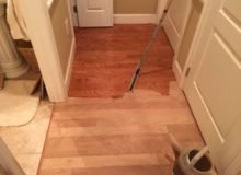 Applying sealer to American Cherry flooring