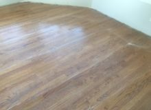 Buffing repaired, refinished red oak flooring