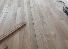 Nickels installed for solid red oak wood flooring expansion joints