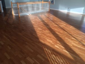 Repaired, sanded, and refinished white oak flooring