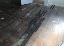 Removing old, water damaged Red Oak wood flooring