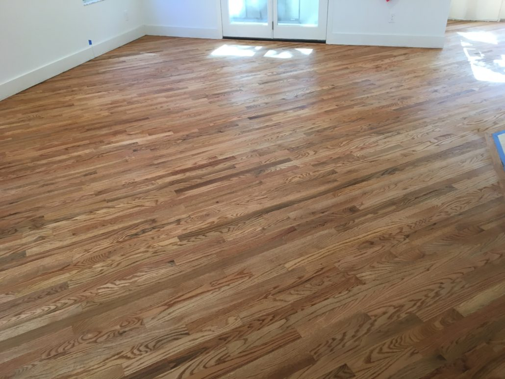 Sanded and finished engineered red oak flooring