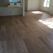 Installed wire brushed white oak wood flooring