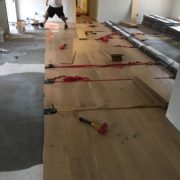 Installing white oak flooring with flooring straps