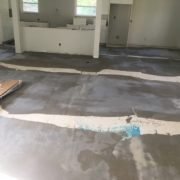 Leveling the concrete slab subfloor