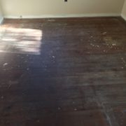 Old heart pine wood flooring, prior to refinishing