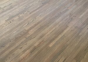 Refinished, grey stained, red oak plank floors