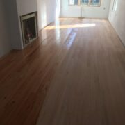 Applying sealer to solid red oak flooring