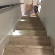 Laminate Oak flooring matches stairway
