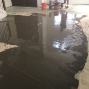 Leveling concrete slab subfloor