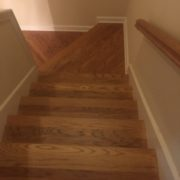 Refinished wooden staircase, rail, and landing