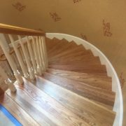 Refinished wooden staircase and rail