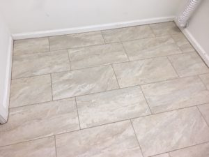 Installed rectangular floor tiles