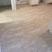 Installed rectangular floor tiles