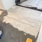 Installing rectangular floor tiles