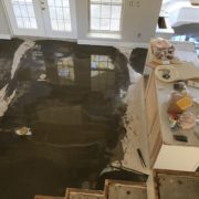 Leveling concrete slab prior to wood flooring installation