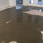 Leveling concrete slab floor for wood flooring installation