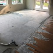 Preparing concrete slab for wood flooring installation - showing drop at rear wall