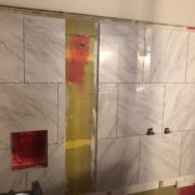 Installing porcelain wall tiles
