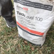 Concrete slab leveling underlayment material