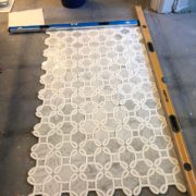 Stone basket weave inlay for bathroom remodel project