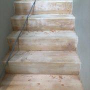 Sanding and hand scraping stairway