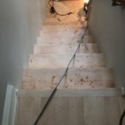 Sanding and hand scraping stairway