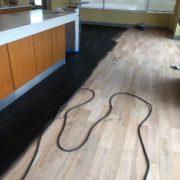 Applying ebony stain - bar wood floor - Matthew's Restaurant
