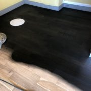 Applying ebony stain - bar wood floor - Matthew's Restaurant